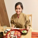 guest with her own making sushi!