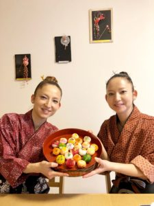 Owner twin sisters with sushi